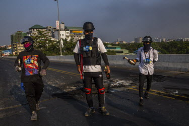 Protestors armed with molotov cocktails which they use to set the road on fire in an attempt to block military and police joint security forces.