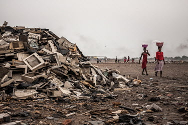 Plastic from e-waste is piled high at Agbogbloshie dump, which has become a dumping ground for computers and electronic waste from all over the developed world. Hundreds of tons of e-waste end up here...