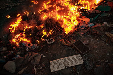 Monitor casings and other plastics burn along the edge of Agbogbloshie dump, which has become a dumping ground for computers and electronic waste from all over the developed world. Hundreds of tons of...
