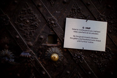 A sign in English and Czech explaining that a gallery and book shop are closed on orders of the government. On 1 March 2021 the state of emergency lockdown in the Czech Republic was reinstalled becaus...