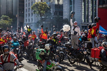 Delivery drivers protest to demand better working conditions for those who work for app-based food delivery platforms amid the COVID-19 pandemic in Sao Paulo. With the economic crisis caused by the co...