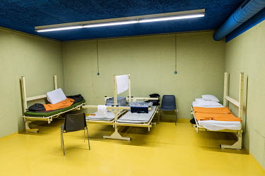 Dormitary beds at a winter emergency shelter for the homeless run by the Ville de Geneve in an abri PC (a civil defence shelter, an underground nuclear bunker), the central beds are left unoccupied du...