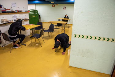 Homeless men in a winter emergency shelter run by the Ville de Geneve in an abri PC (a civil defence shelter, an underground nuclear bunker).