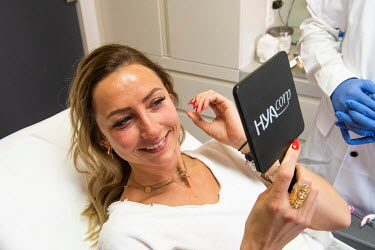 Emilie discovering her new look following injections of hyaluronic acid fillers given by Dr Herve Raspaldo at the Imaderm Clinic. Emilie says she is doing this partly to feel better on Zoom, which due...