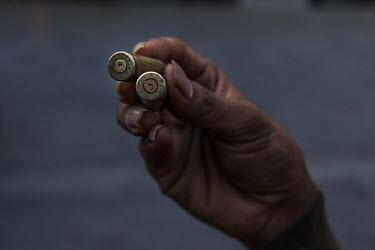 An anti-coup protestor holds bullet casing left after the security forces opened fire as they cracked down on demonstrations in the Hlaingtharyar industrial zone on the outskirts of Yangon.