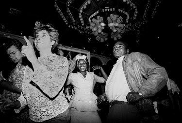 Black and white people dancing at the Summit Club disco on a Saturday night in Hillbrow.