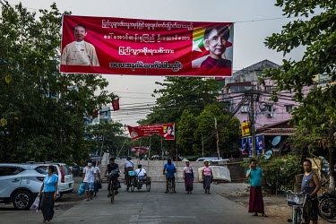 A neighbourhood displaying banners of Aung San Suu Kyi and Win Myint. Local residents have constructed barricades at the end of its street to try and prevent security forces from entering the area.