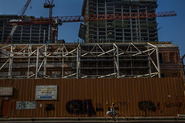 A notice offering work to construction workers and labourers on a fence surrounding the construction site of Peninsula Yangon, a 130 million USD development that was, according to past media reports,...