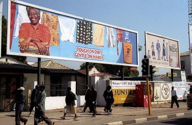 A billboard advertisement for washing detergent in central Lusaka.