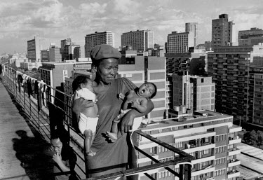 A woman and her twins on the roof of Hillbrow flats.