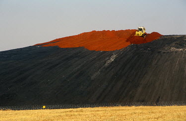 A coal mine's tailings pile being rehabilitated and covered with topsoil.