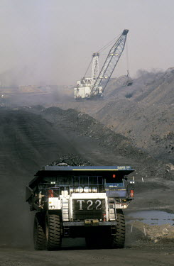 A truck moves coal at the Arthur Taylor Colliery, while a Dragline, which is the huge crane like machine, workings in the background.