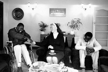 Sister Cecelia with Roger (L) and Phenias, who are both HIV positive, at the Sacred Heart House AIDS hospice.