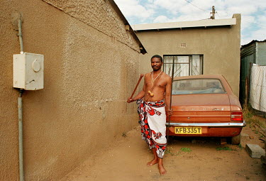 A Sangoma (witch doctor) at his home.