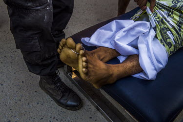The dead body of a protestor who died from a gunshot wound to the chest arrives at a hospital.