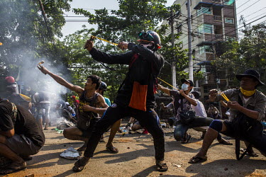 During a clash with security forces, protestors use homemade catapults and slingshots, to try and stop the police and military forces from entering into their neighbourhood in Tharketa township.