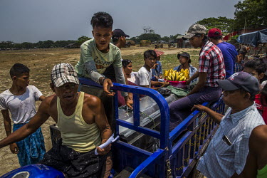 Friends and relatives of Aung Zin Myint, gather beside his coffin being transported in the back of a cart driven by his father. The 20 year old student was shot in the chest and arm by the security fo...