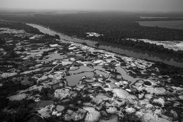 An area degraded by gold mining, located on the banks of the Peixoto de Azevedo River in northern Mato Grosso. This region that was once covered by the Amazon rain forest but has been cleared to make...