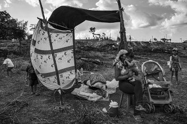 A homeless family builds an improvised shack on squated land invaded by landless people on the outskirts of Manaus, next to the city's Industrial Zone.