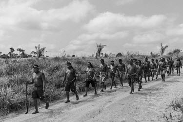 Xikrin warriors arrive at Rapko village after a jungle expedition to remove invaders from the Trincheira Bacaja Indigenous Land which had part of their area invaded and cleared by land grabbers. Aband...