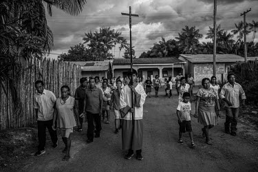 People participate in a Catholic procession in a city where about 90% of the 45,000 inhabitants are indigenous people.