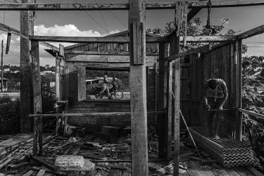 A resident of Altamira's stilt houses who was forced to relocate because of the construction of Belo Monte dam, dismantles his house to reuse this material to build a new home or to expand the footpri...