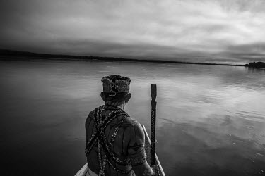 A Munduruku Indian navigates the waters of the Tapajos river.