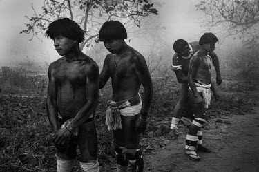 Indigenous Indians prepare to attend a funeral ceremony at Yawalapiti Village amidst the smoke that has covered the Xingu Indigenous Park due to the large number of forest fires.