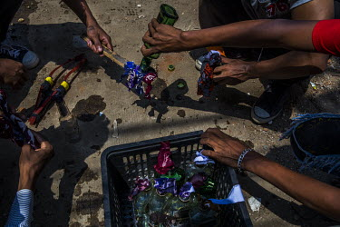 Anti-coup protestors prepare molotov cocktails ahead of a crack down by the security forces in Tharketa township.