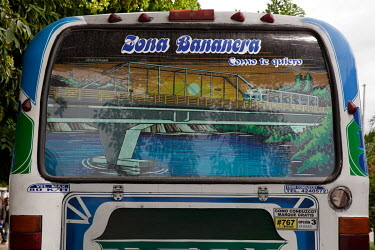 A picture in the back window of a coach bearing the slogan 'Zona Bananera, how I love you'.