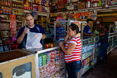 Farides Farid Cantillo Silva shopping for groceries in Cienaga.