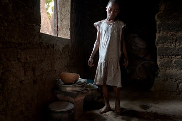 Bedine (10), a housekeeper for a local family. Its not unusual for the families of young girls to send them to work to wealthier families, to help with household chores.