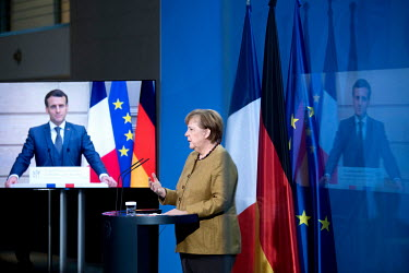 French President, Emmanuel Macron, speaks with Chancellor Angela Merkel from Paris via video link during a conference press call at the Chancellery Office.