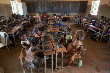 Children sit at their desks in a crowded class at the Zoodnooma Primary Public School.