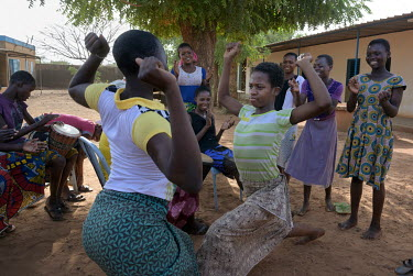 Abibou (13) and Edith dancing in the grounds of the Foyer Sainte Maria de Goretti. Both girls fled forced child marriages and have found refuge at the centre which, since 1951, has been welcoming youn...