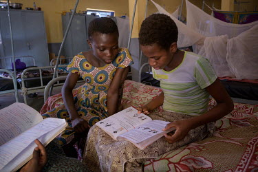 Abibou (13) (right), who arrived at the home a year ago to escape a child marriage, does her studies with one of her friends in their dormitory at the Foyer Sainte Maria de Goretti which since 1951 ha...