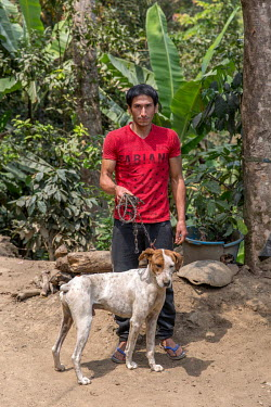 Alixer Guevara Santos (30) with his dog.