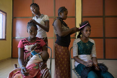 Rosalie (L) in her third and last year of hairdressing training at the Foyer Sainte Maria de Goretti. She fled her family to avoid forced marriage. On the right Odile, in her first year of training, a...