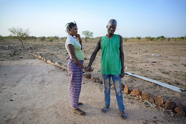 Aicha (13) with Attika (39) arriving late at school. With a critical lack of information on contraception among young people, Aicha found herself pregnant with Attika, whom she will marry shortly on a...