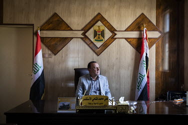 The Mayor of Bartella, Ali Iskander a Shiite Muslim Shabak, in his office.   Prior to being overrun by ISIS in August 2014 the town was majority Christian but following its liberation, on 20 October 2...