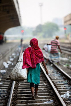 A girl collecting recylable waste at Kamalapur Railway Station (officially known as Dhaka railway station).