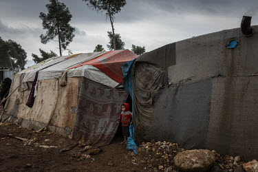 Refugees displaced during a 2020 Syrian regime offensive in nearby Idlib now living in a sprawling tented camp on a muddy hill above the city of Afrin.