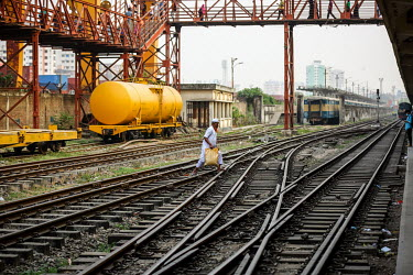 A man crossing the tracks at Kamalapur Railway Station (officially known as Dhaka railway station).