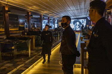 Waiters wearing face shields and masks wait to serve customers at the Sky Lounge in the newly opened Dawa restaurant in the Jadriyah neighbourhood. Despite COVID-19 still being present in the country,...