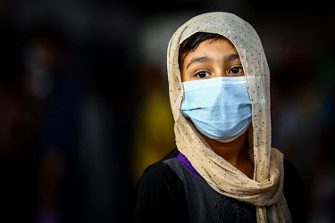 A girl wearing a face mask at Kamalapur Railway Station (officially known as Dhaka railway station).