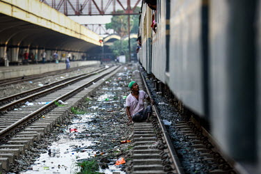 A man begging at Kamalapur Railway Station (officially known as Dhaka railway station).