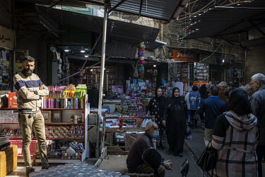Stall holders and shoppers in the al-Shorja market which remained busy during early 2021 despite COVID-19 still being present in the country. The government's restrictions to control the spread of COV...