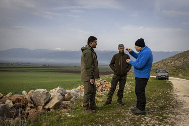 Professor Yasar Ergun speaks with his colleagues Hasan Dinler (left) and Huseyin Dinler (right) who work as keepers in the protected zone Ergun helped create for the nearly extinct mountain gazelle (G...