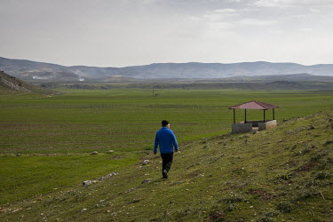 Professor Yasar Ergun walks towards a hide he built to observe wild mountain gazelles (Gazella gazella) in the protected zone Ergun helped create for the nearly extinct antelope near the Turkish/Syria...