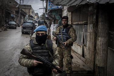 Turkish-backed Syrian security forces on guard in the heavily-secured market area of downtown Afrin.